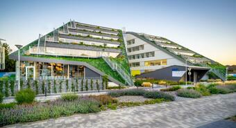 Modern green buildings compete with architectural monuments
